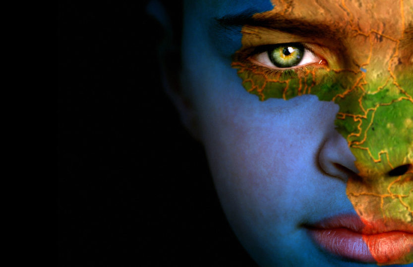 Portrait of a boy with the map of the world painted on his face